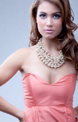 This bridesmaid looks fancy with her large, multi-strand pearl necklace.