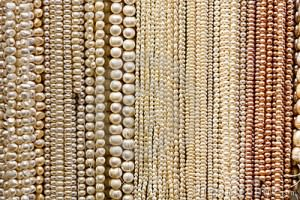 Strands of pearls together.