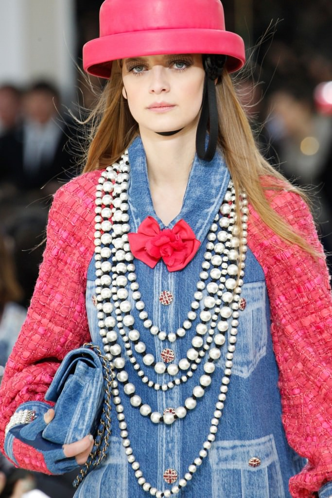 The Timeless Pearl: Chanel runway model wearing layers and layers of pearl necklaces.
