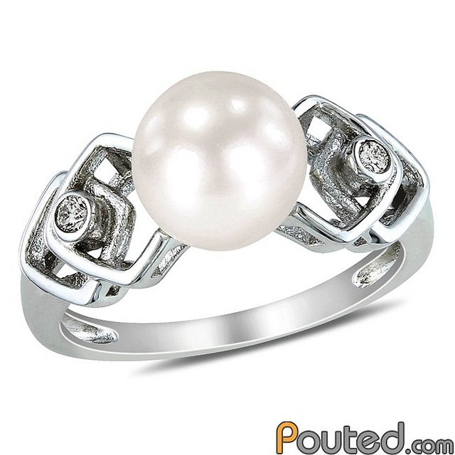 Pearl wedding band with diamond chips encrusted in white gold setting.