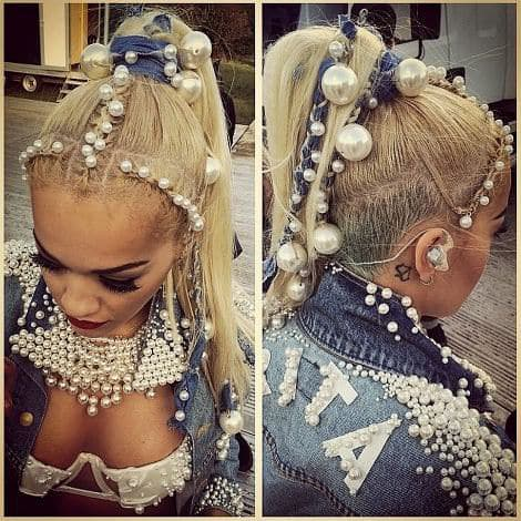 Rita Ora Wearing a Personalized Pearl-Embellished Denim Outfit with Pearl Jewelry and Accessorie with Pearls Woven into Her Hair