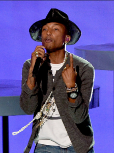 Pharrell Williams Wearing Pearls on Stage... Because Real Men Wear Pearls Too!