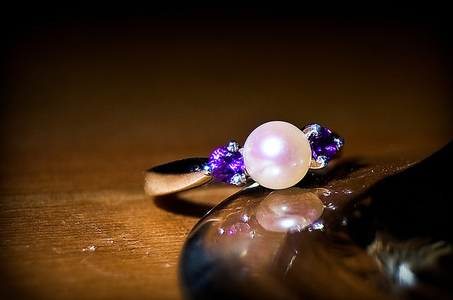 Amethyst & pearl engagement rings represent the birthstones of the bride and groom.