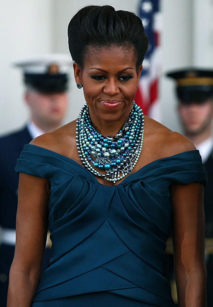 Michelle Obama loves her pearls. Here she's wearing numerous strands of blue pearls. And, she looks amazing in them!