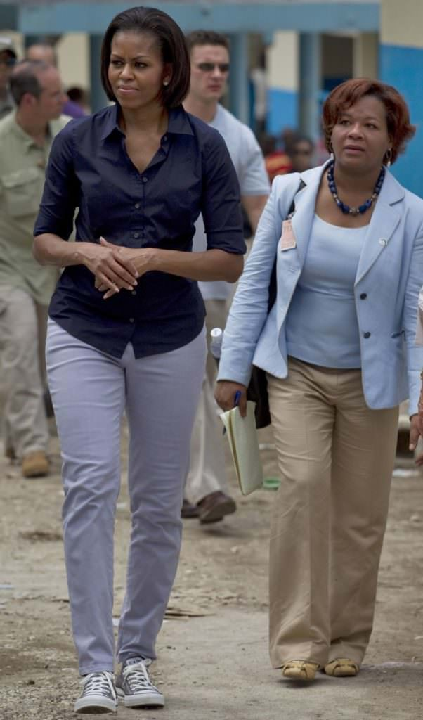 Michelle Obama went to Haiti to put in work. Here she in tennis shoes with her sleeves rolled up.
