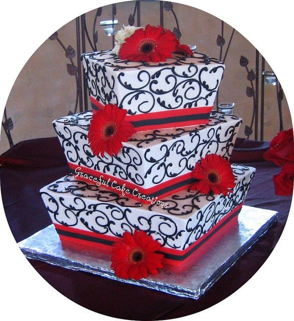 This red, white and black geometric wedding cake is not only unique, it looks amazing.