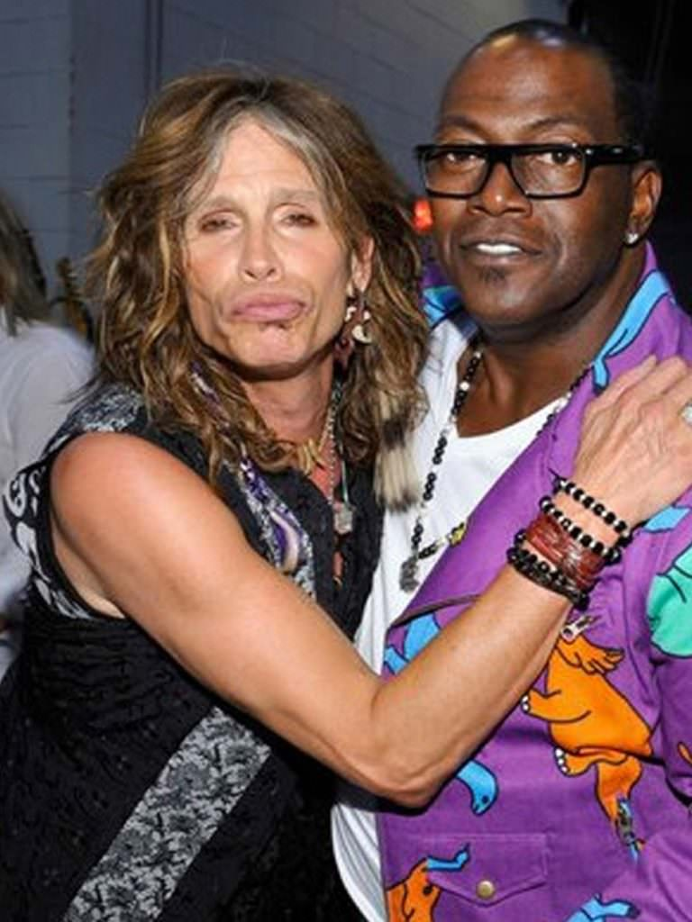 Randy Jackson Steven Tyler wearing pearl necklaces.