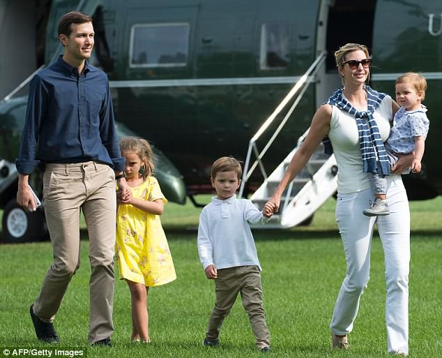 Even on a casual day, Ivanke Trump loves her pearl earrings. Shown with husband and all three of their kids.