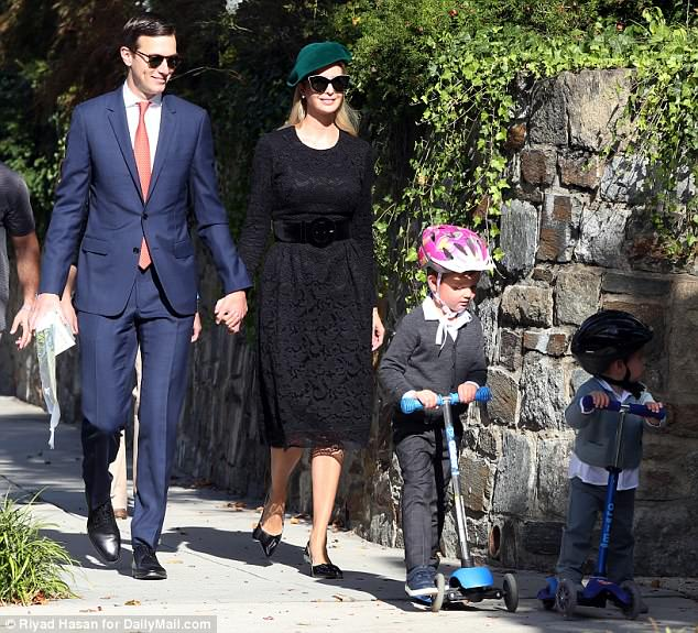 Ivanka Trump looks daring in this all black dress and pearl earrings. Shown with husband and two of their kids.