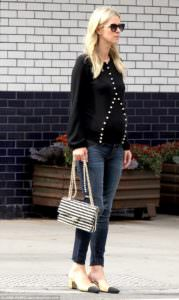 Pregnant Nicky Hilton looks like pure royalty in a pearl embellished sweater. Check out that awesome purse with the pearl straps.