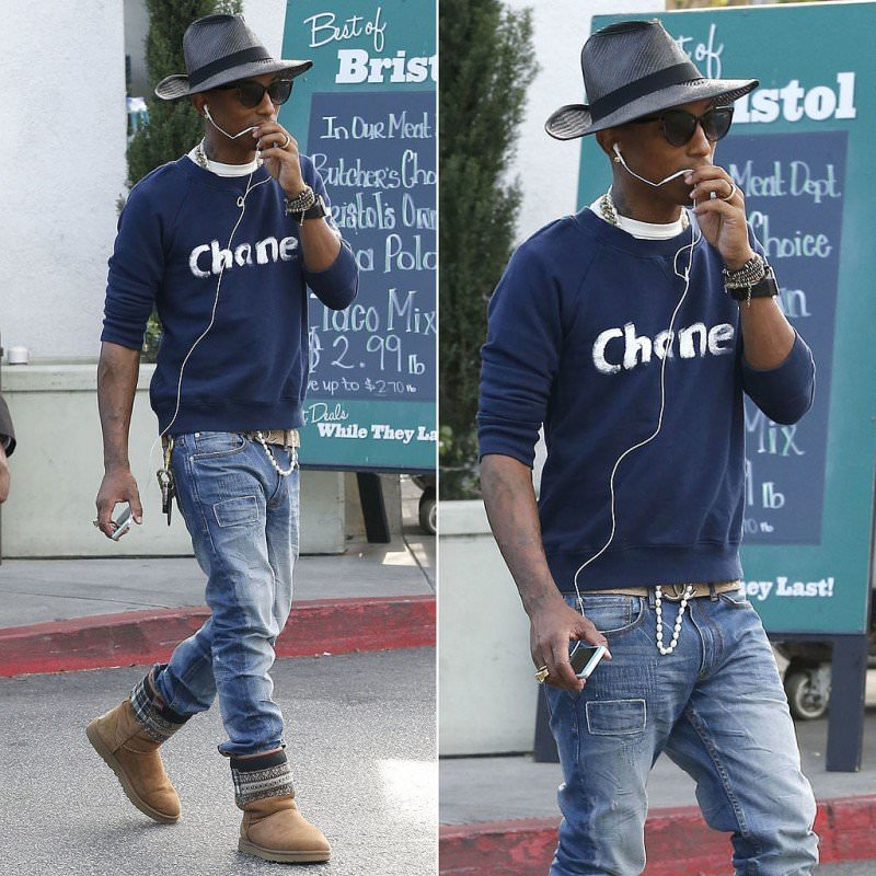 Pharrell Williams is a sexy man wearing pearls on a casual day.
