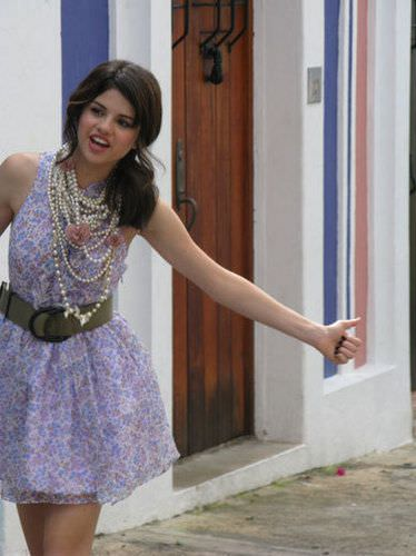 Selena Gomez during a photo shoot for Teen Vogue, wearing loads of strands of pearls.