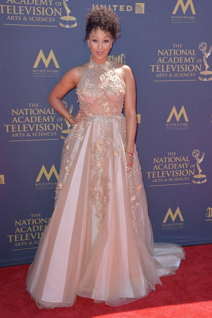 Who Wore Pearls? Tamera Mowry-Housley looks like pure elegance in this pearl-embellished formal evening gown at the Emmy's.