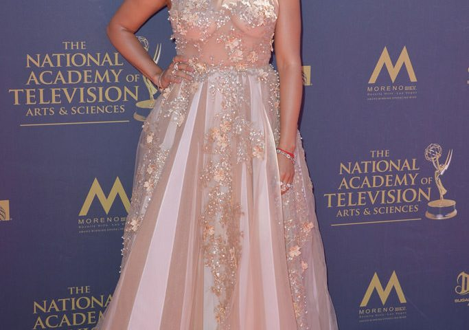 Tamera Mowry-Housley looks like pure elegance in this pearl-embellished formal evening gown at the Emmy's.