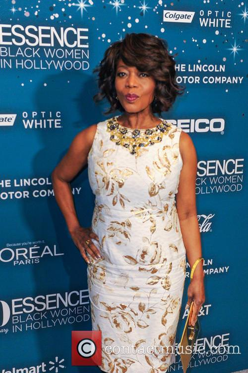 At 65, Alfre Woodard looks more than amazing in this tight fitted white dress with gold accents and silver highlights.