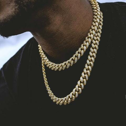 Even men love gold. This Diamond Cuban Link Choker in Yellow Gold makes any man look sexy.