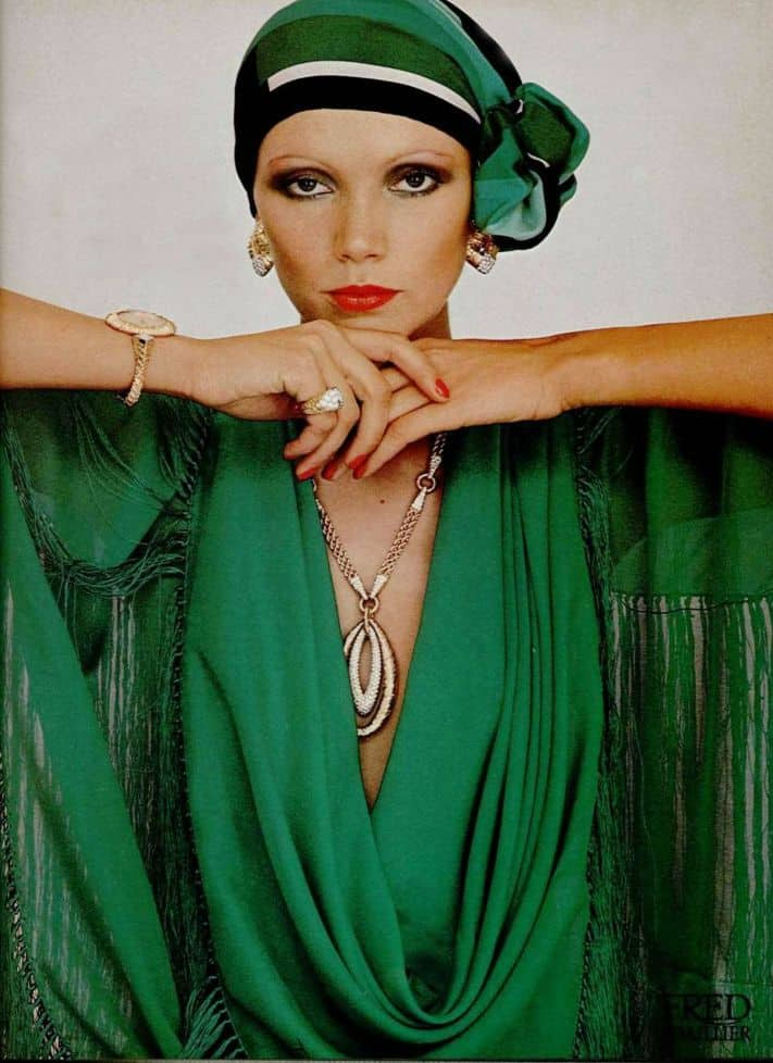 Check out the 1976 look featuring a large gold medallion and other huge jewelry pieces.