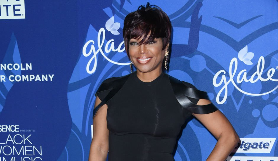 Michel'le is a woman of many amazing styles. Here she is with short hair in a sleek black dress.