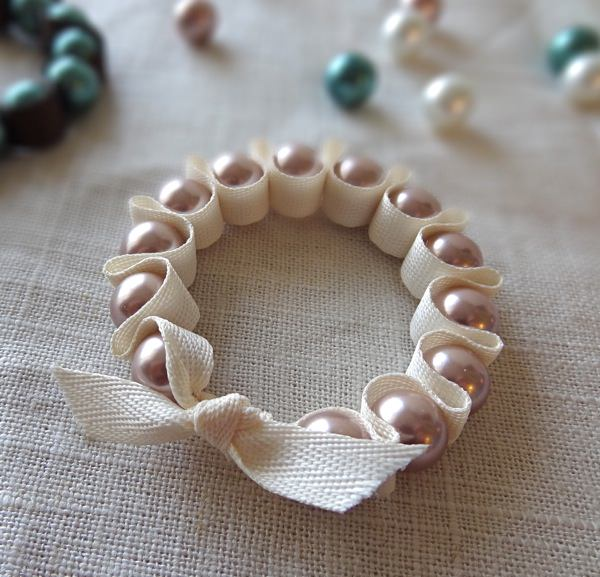 Pink Pearls Set in a Folded Ribbon Bracelet