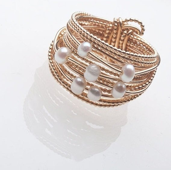 Layered pearl and metal rings.