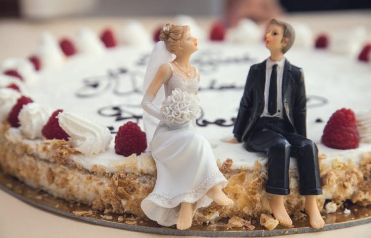 Bride Groom Sit on Cake