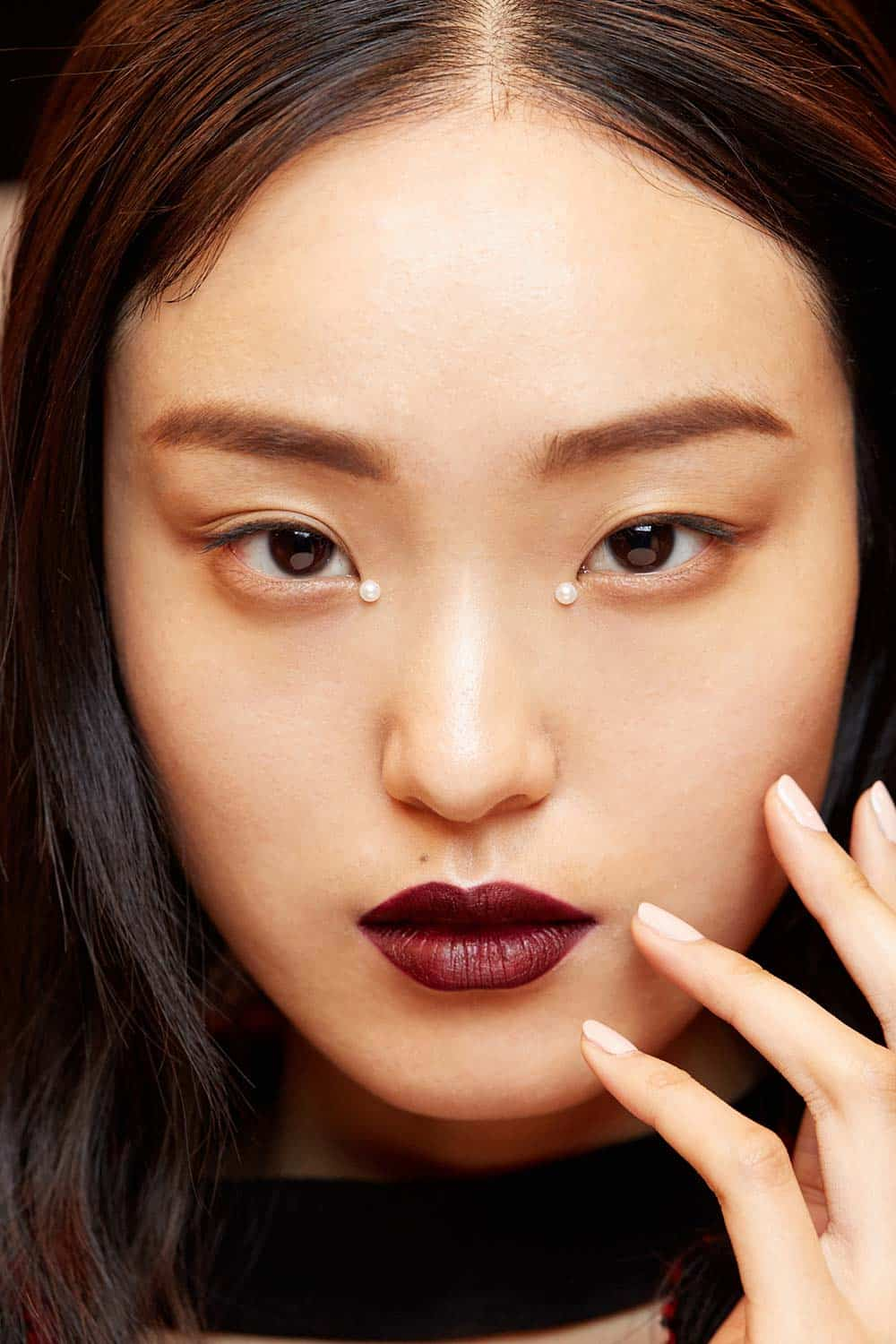 This Jonathan Simkhai model looks exotic with a tiny pearl glued to the corner of each of her eyes.