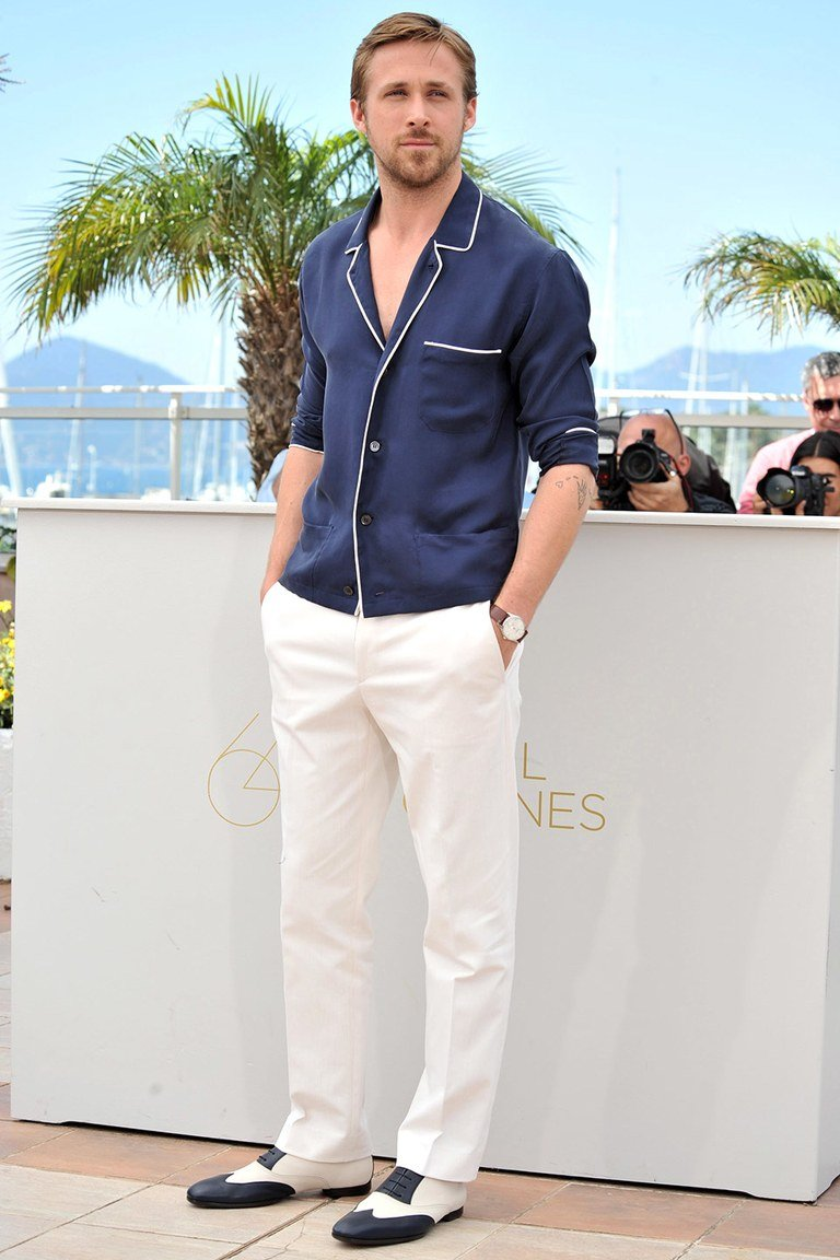 Ryan Gosling wearing a pajama shirt and white slacks at the Cannes Film Festival.