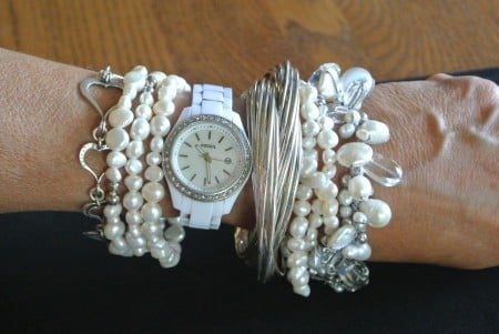 Layered pearl bracelets with other types of bracelets