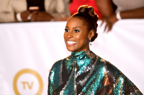 Issa Rae of Insecure loves her sequins. She wore this long sequins dress with dangling Tiffany earrings to the 2018 NAACP Image Awards.