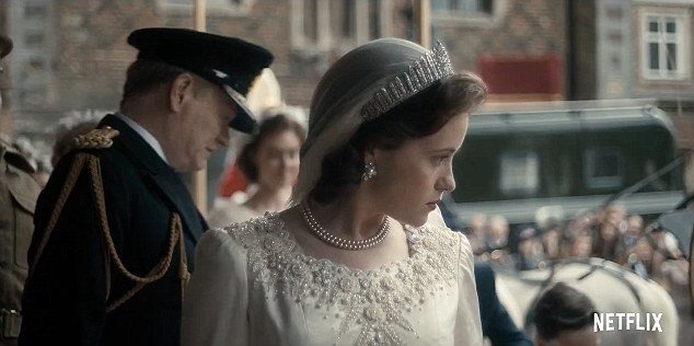 A Royal Wedding of The Crown: Queen Elizabeth Weds Philip wearing a diamond tiara and layered pearl necklace.