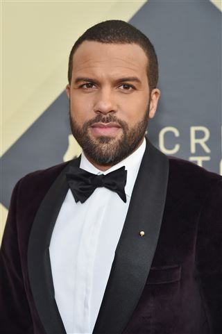 O. T. Fagbenle wore a pearl pin to the SAG Awards.