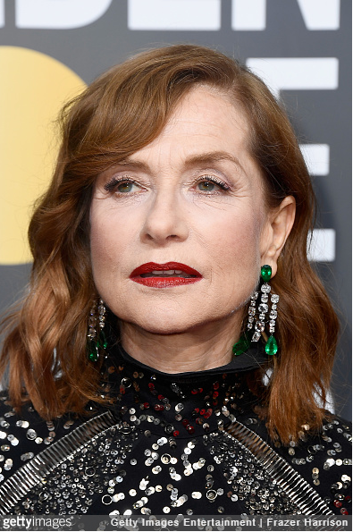 Isabelle Huppert wearing emerald and diamond earrings.
