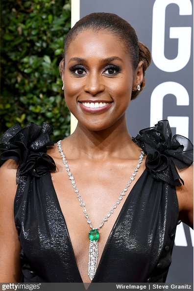 Issa Rae wearing a diamond and emerald necklace.