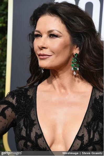 Catherine Zeta-Jones wearing diamond and emerald earrings.