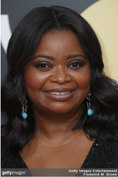 Octavia Spencer wearing diamond and turquoise earrings.