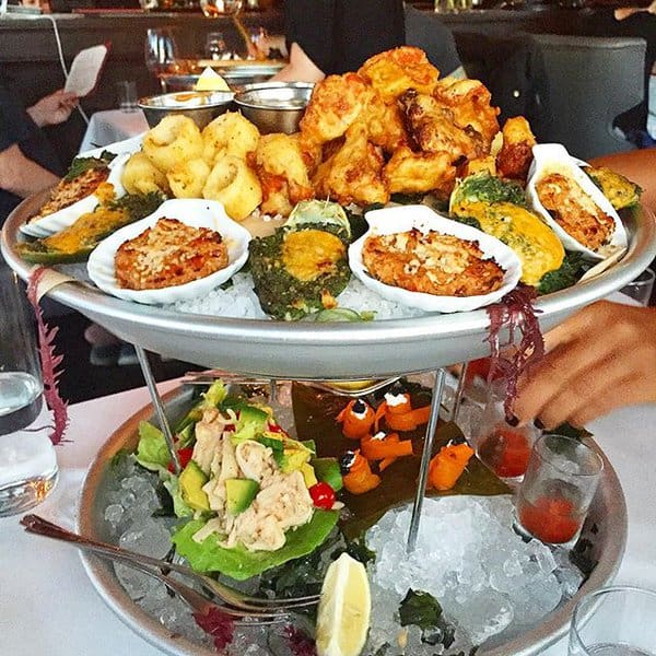 Vegan seafood tower from Crossroads in Los Angeles, CA. Plant-based versions of oysters, lox, caviar, & calamari.