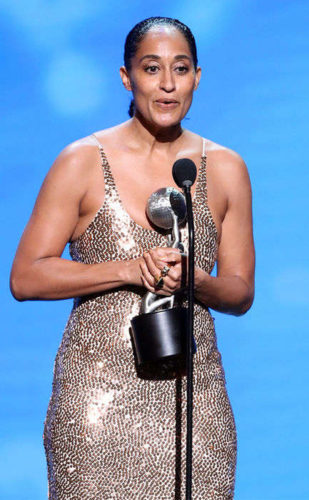 Tracee Ellis Ross accepts her Image Award for Outstanding Actress in a Comedy Series on black-ish wearing sequins and huge rings.