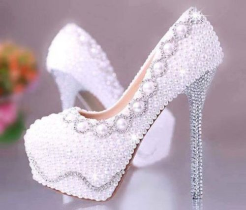 Check out these pearl-embellished stilettos. Aren't they perfect for the boss lady headed to a stunning business affair?