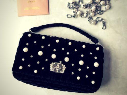Now, how gorgeous is the pearl embellished black velvet handbag?