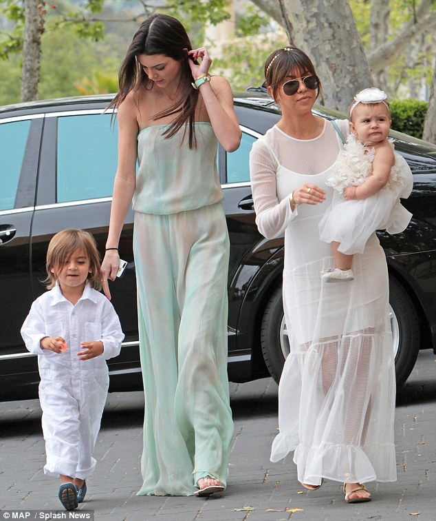 The Kardashian clan heads to church.